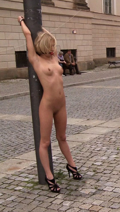 Naked Woman Tied To A Lamppost