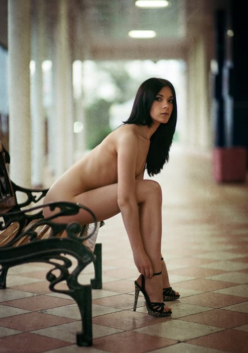 Naked woman in heels
