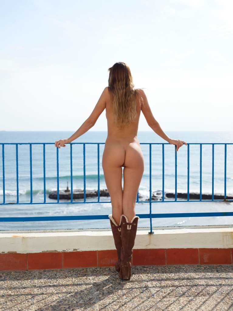 Naked woman by the sea