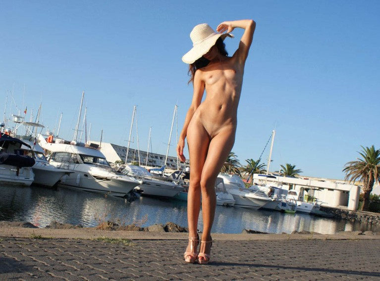 Naked woman by a harbour