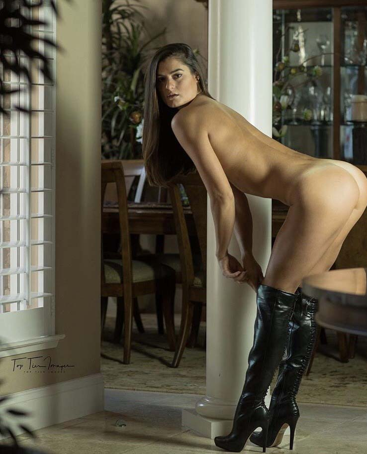 Naked woman in thigh high boots
