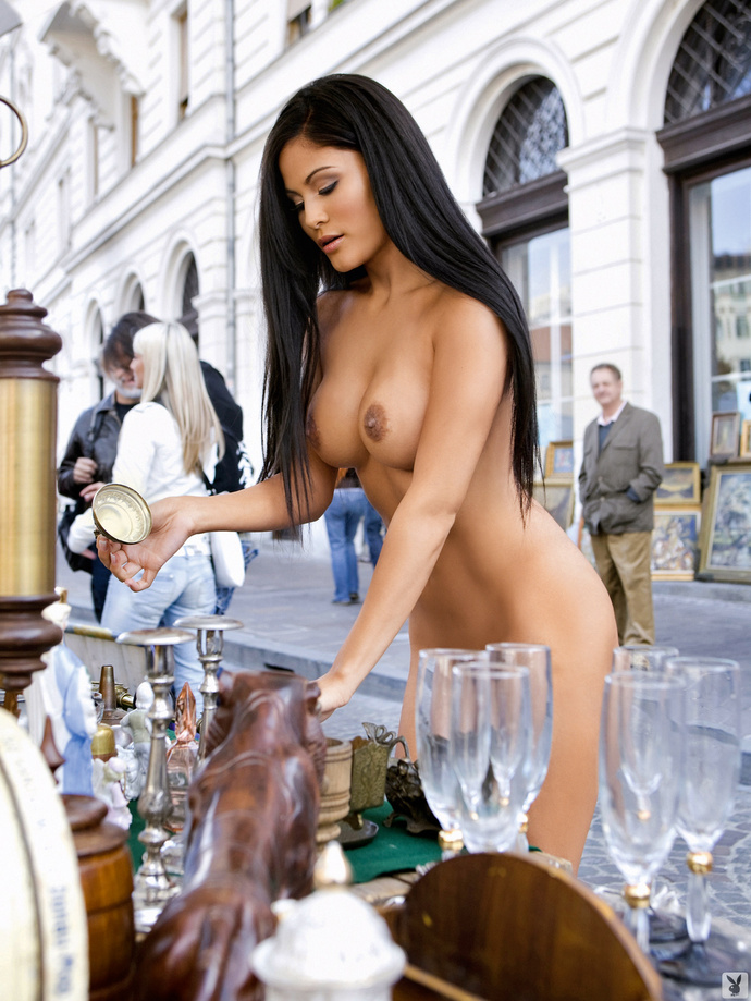 Naked woman at antiques stall