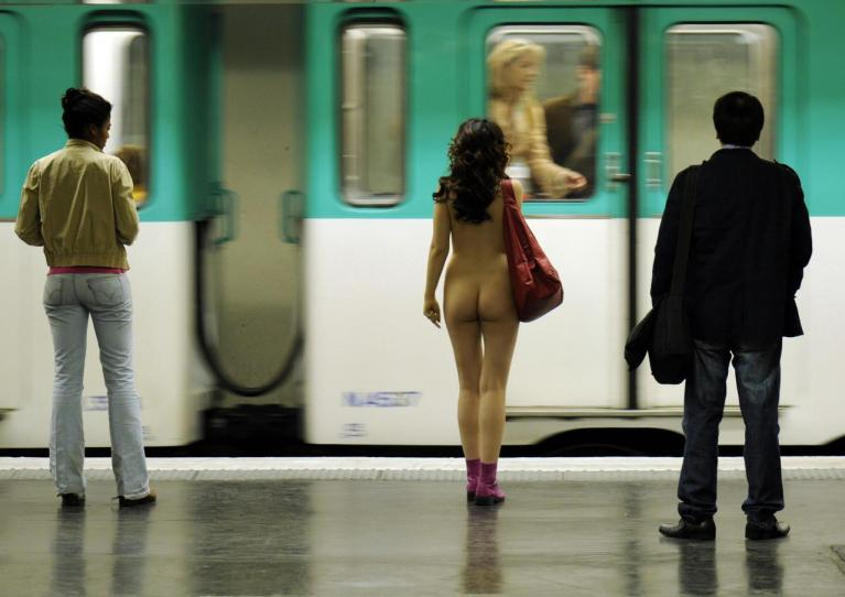Naked woman on a train platform