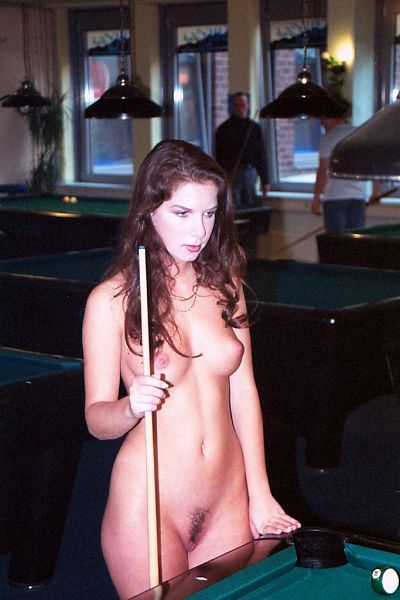 Naked woman at a pool table