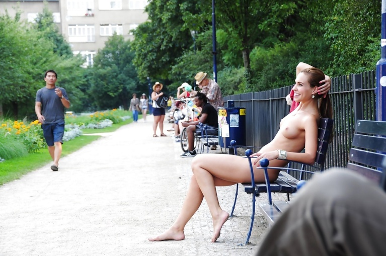 Naked woman on a park bench