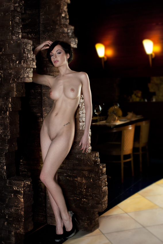 Naked woman in a public bar