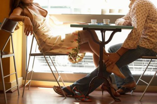 Couple sat at a cafe table
