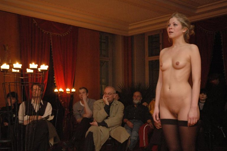 Naked woman in stockings in a crowded room