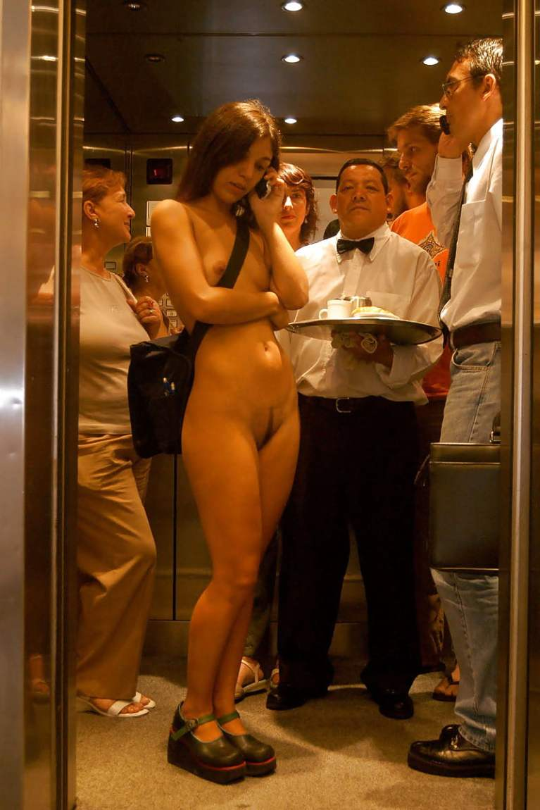 Naked woman in an elevator with clothed men and women