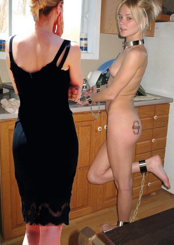Naked woman in chains doing housework