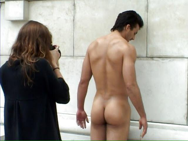 Woman photographing a naked man