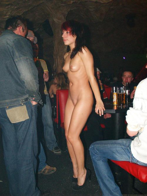 Naked woman in heels at a nightclub