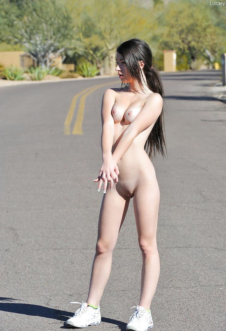 Naked girl standing in the street