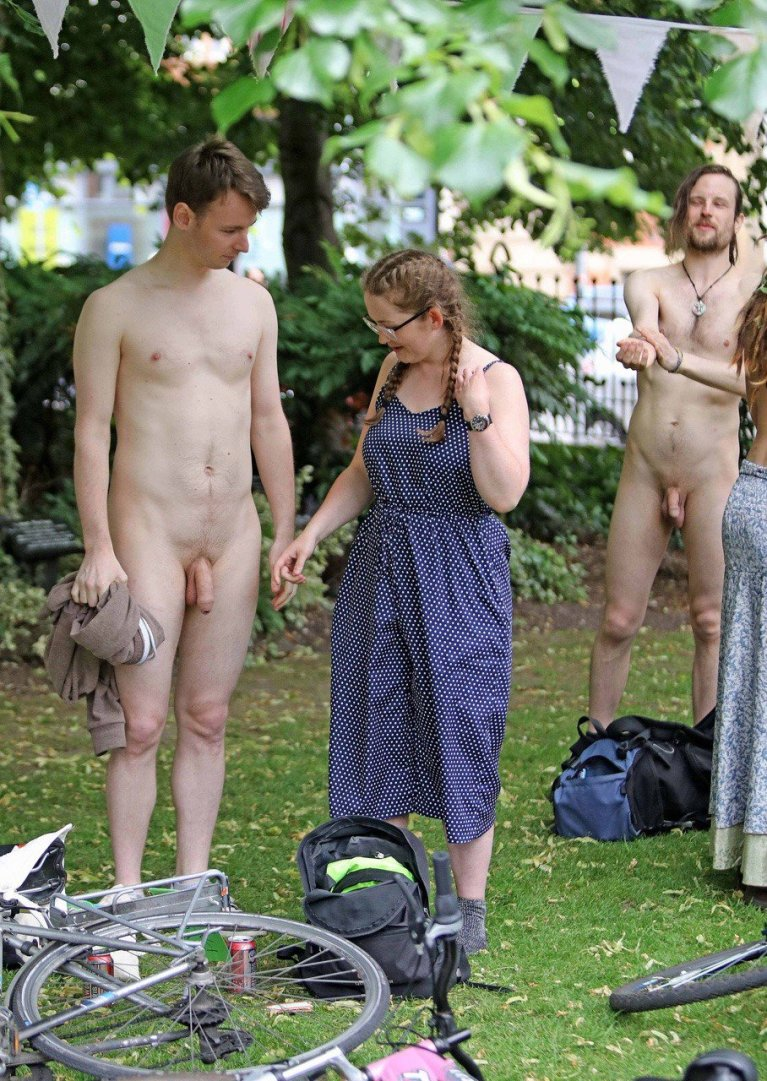 Naked man with clothed woman and bike