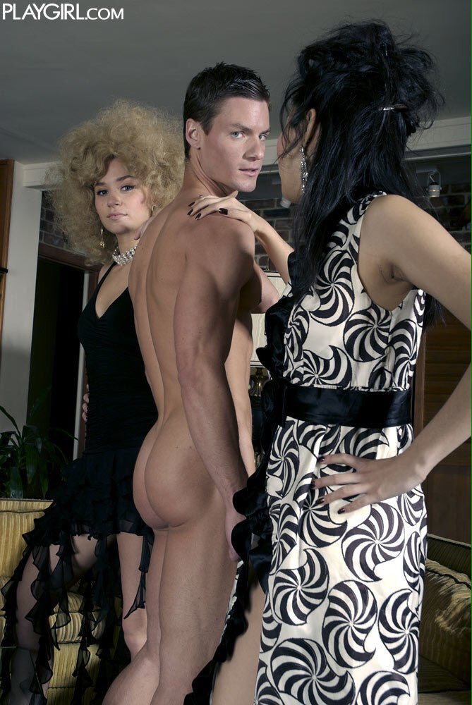 Naked man between two elegant women