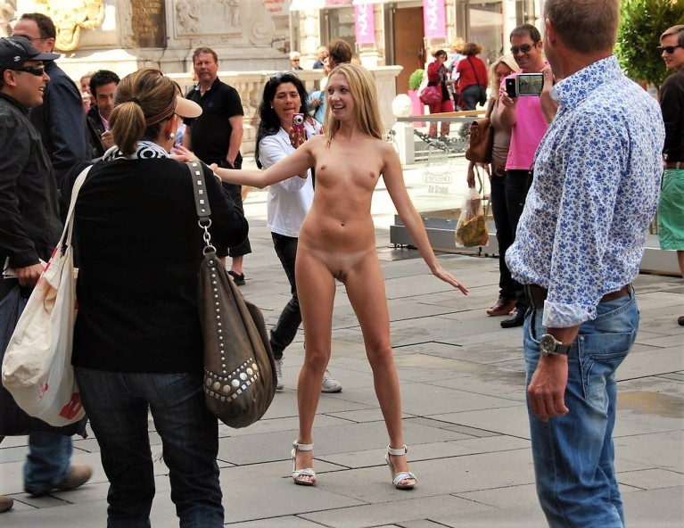 Naked woman outside in a crowd