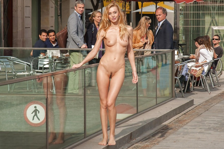 Naked woman outside a cafe