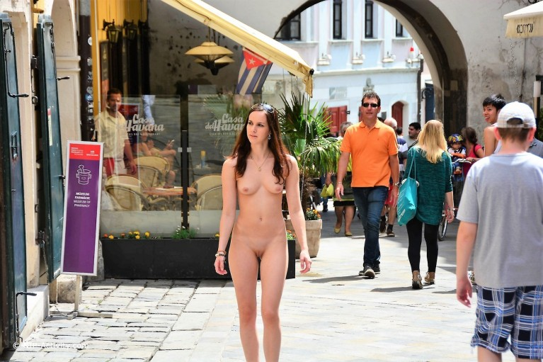 Naked woman in a city street