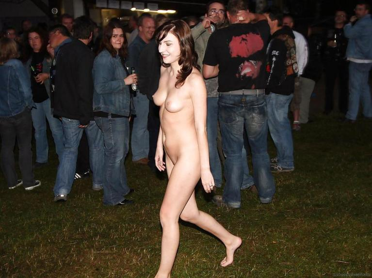 Naked woman in a crowd at night