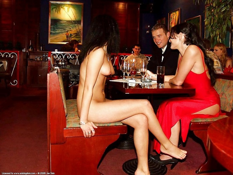 Naked woman in a restaurant with clothed couple