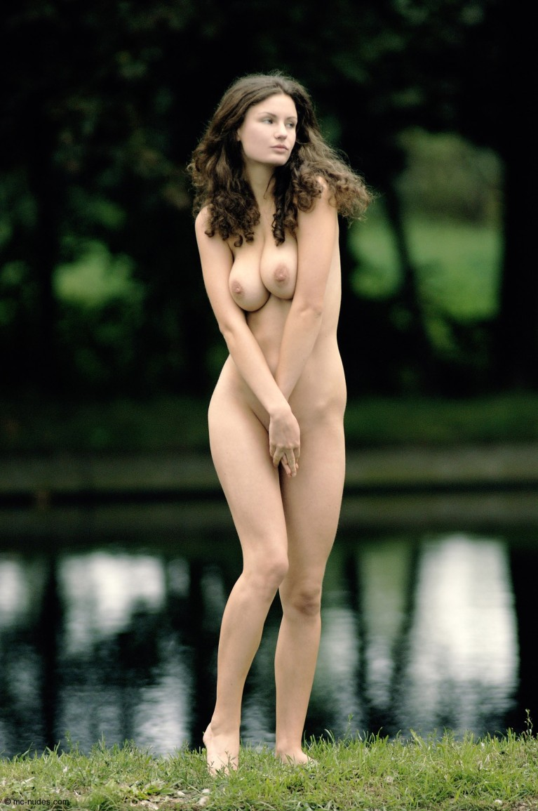 Naked woman by a lake