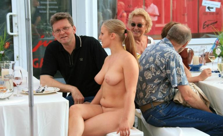 Naked woman at an outdoor cafe