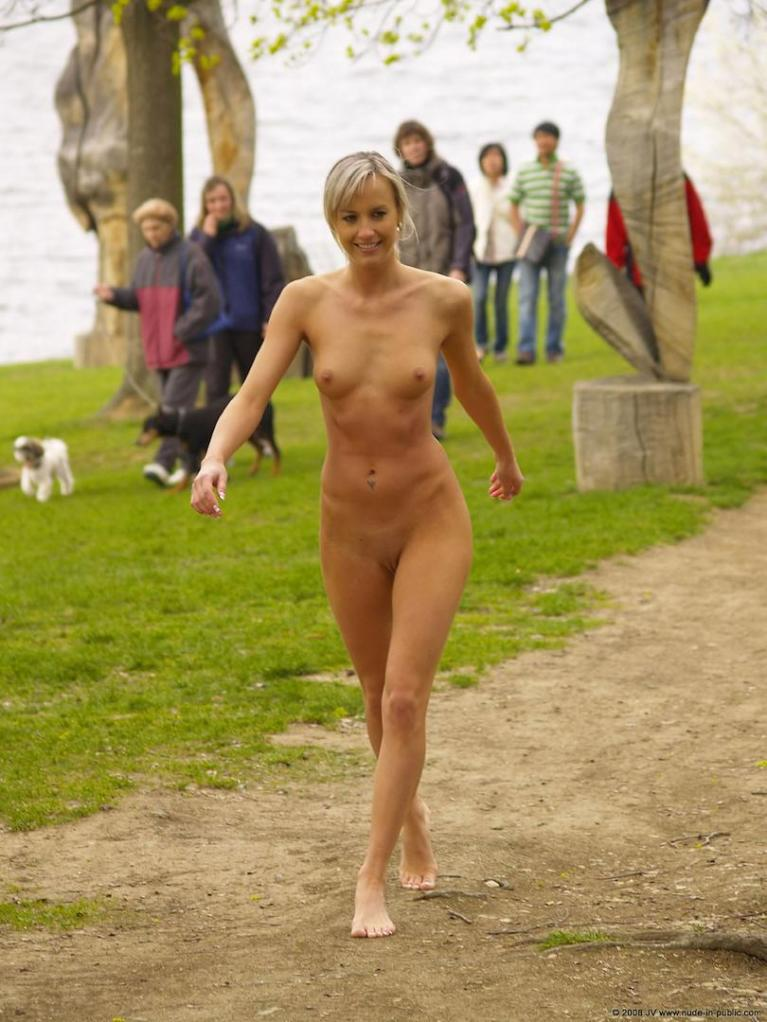 Naked woman in public park