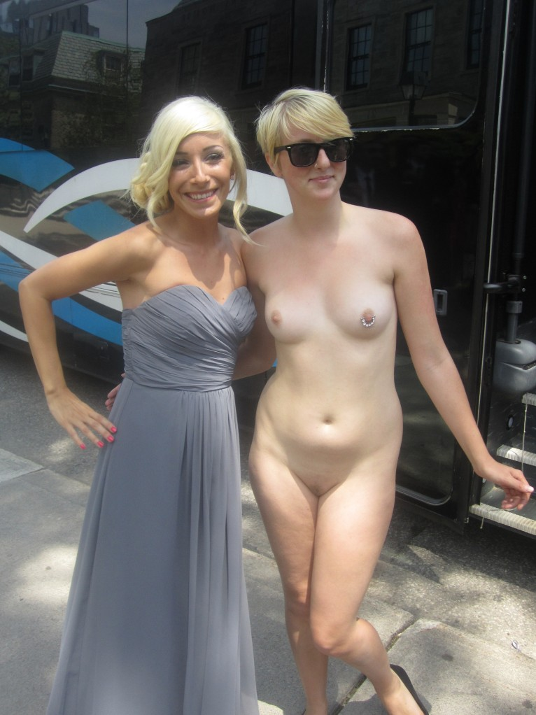 Naked woman besides clothed woman