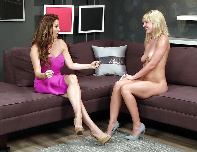 Naked woman being interviewed by clothed woman