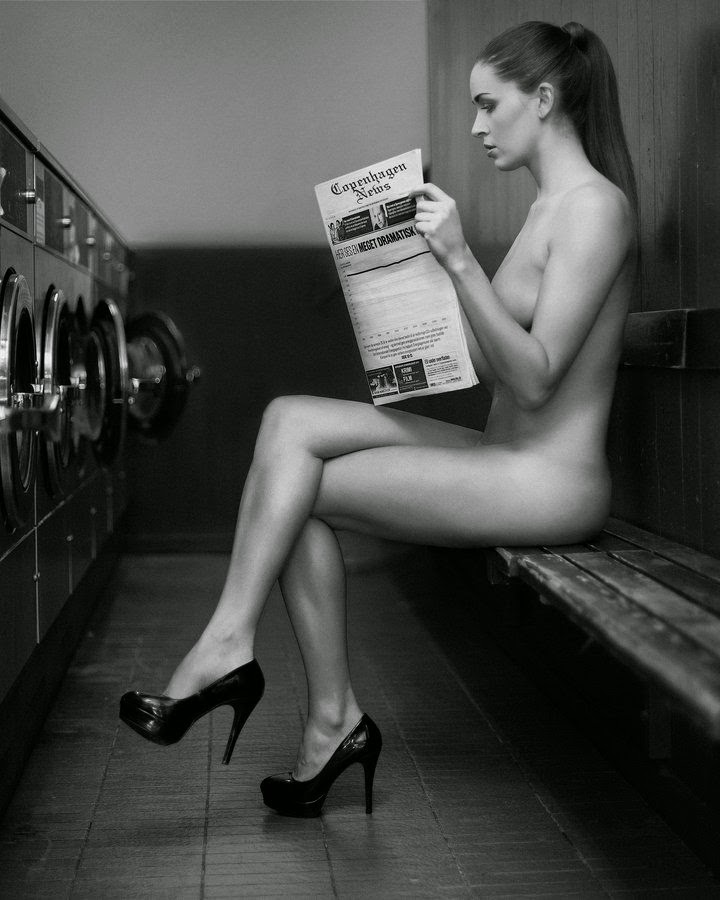 Naked woman in a launderette