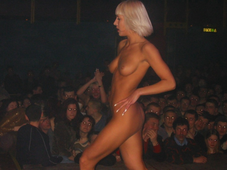 Naked woman in front of crowd