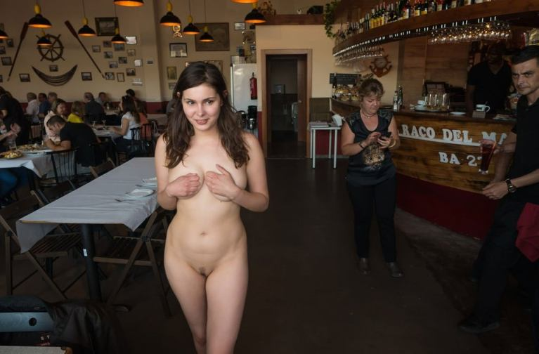 Naked woman walking through a restaurant