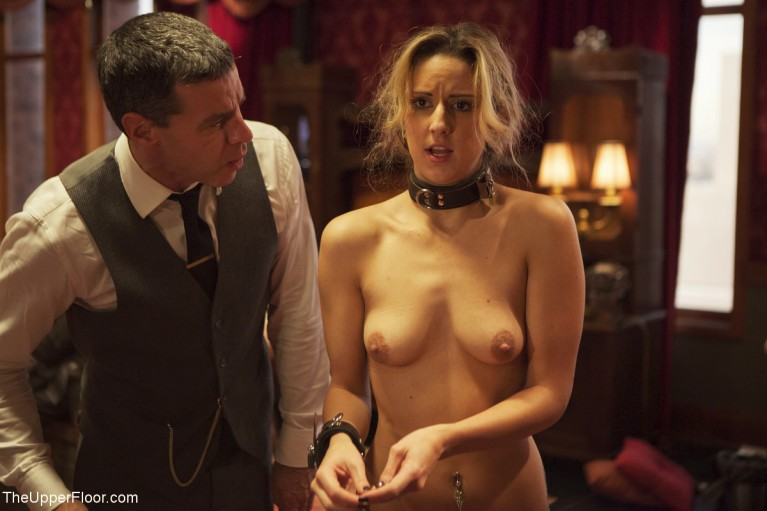 Naked woman in cuffs and collar