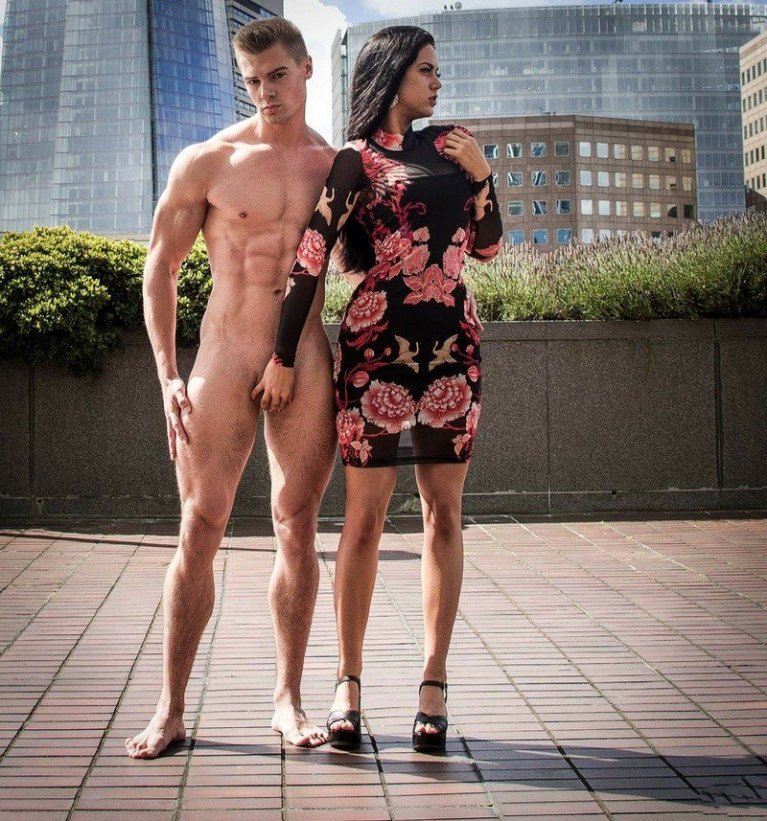 Naked man having testicles held by a clothed woman