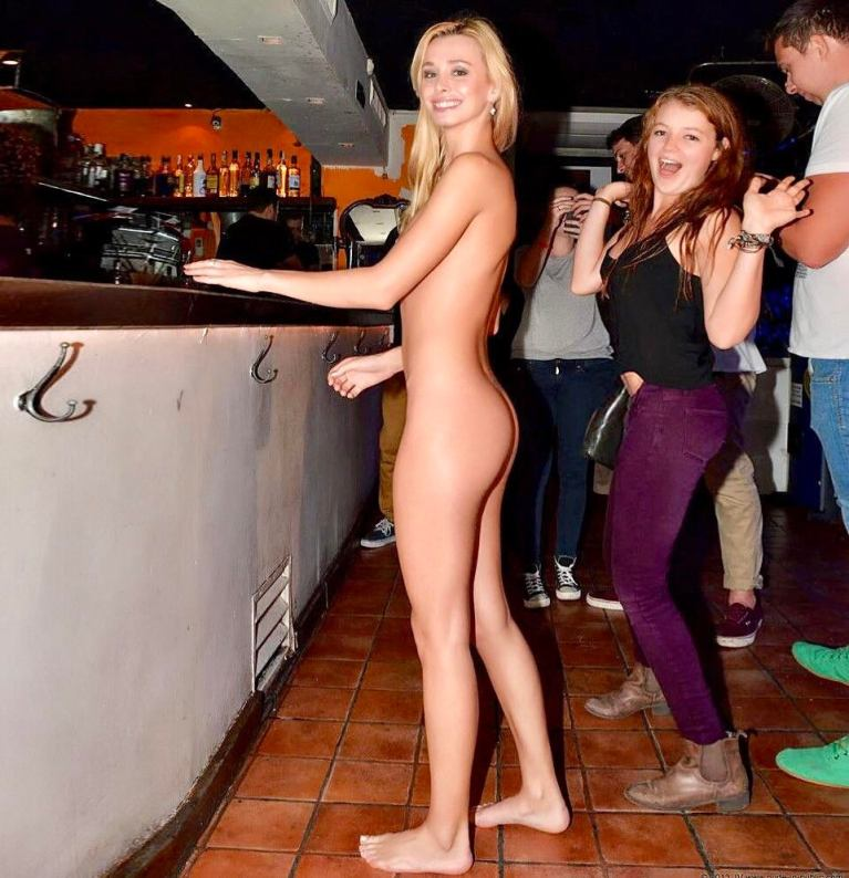 Naked woman in a crowded bar