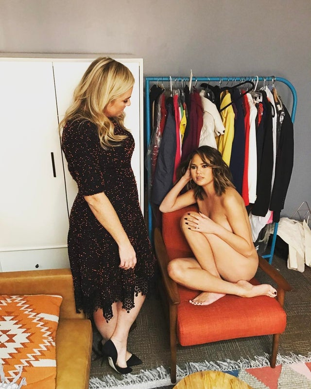 Naked woman in a chair talking to clothed woman